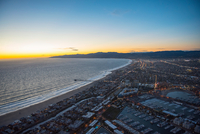 Aerial view of Venice and Santa Monica beach and distant Santa Monica Mountains and Hollywood Hills at sunset, California, USA