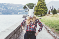 Portrait of woman wearing rabbit mask with hands on hips, Lake Como, Italy 11015287420| 写真素材・ストックフォト・画像・イラスト素材|アマナイメージズ