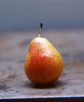 Comice pear on wooden table, close-up
