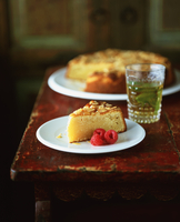 Slice of almond polenta cake with raspberries