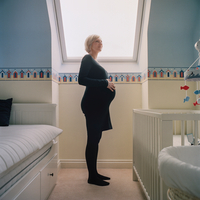 Side view of pregnant woman in nursery