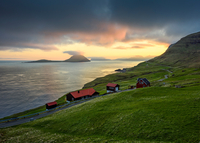 Buildings on hillside by ocean, Velbastadur, Faroe Islands