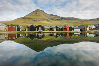 Reflection of mountain and buildings in water, Leirvik, Faroe Islands