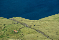 High angle view of building on cliff top, Vagafjordur, Faroe Islands