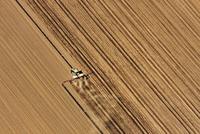 Tractor in field, aerial view, Lausitz, Brandenburg, Germany