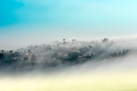 Mountainous rural village covered in mist, Carmel Mountain, Israel