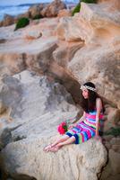 Girl resting on rocks