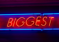 Neon sign of the word biggest