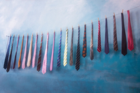 Ties hanging on string with clothes pegs