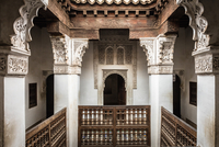 Wooden balcony and marble pillars at Ben Youssef Madrasa, Marrakech, Morocco