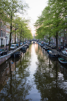 View of canal between townhouses in spring, Amsterdam, Netherlands