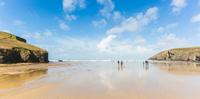 People on beach, Mawgan Porth, Cornwall, UK