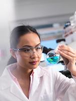 A scientist preparing a chemical formula in a laboratory