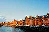 Old warehouses on waterfront at sunset, Hafencity, Hamburg, Germany