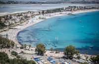 High angle view of crowded tourist beach and hotels, Cagliari, Italy