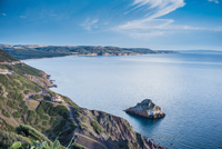 High angle view of blue sea and coastline, Masua, Italy