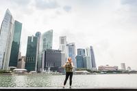 Tourist sightseeing, Singapore skyline, Marina Bay