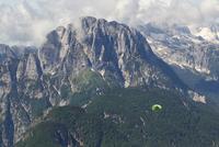 Lone paraglider paragliding in Julian Alps, Bovec, Slovakia