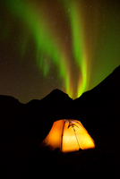 Illuminated tent and Aurora borealis at night, Khibiny mountains, Kola Peninsula, Russia