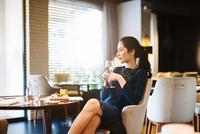 Young woman staying in boutique hotel enjoying aperitif