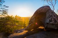 Boulder, sunset over forest