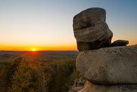 Boulders, sunset over horizon