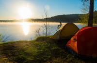 Tents by lake at sunset