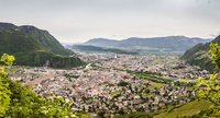 Elevated view of town in mountains, Bozen, South Tyrol, Italy