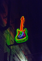 Guitar-shaped neon sign on building, New York, USA