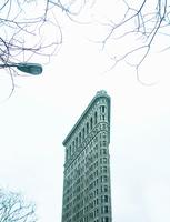 Low angle view of flatiron building, New York, USA