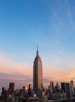 Empire state building on skyline at sunset, New York, USA