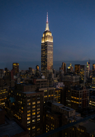 Empire state building illuminated at night, New York, USA