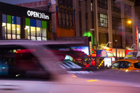 Blurred motion of taxis on street at night, New York, USA