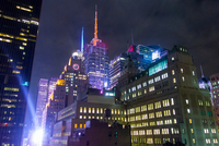 Low angle view of buildings illuminated at night, New York, USA