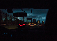 View through windscreen of taxi on Brooklyn bridge at night, New York, USA