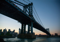 Low angle view of Manhattan bridge at sunset, New York, USA