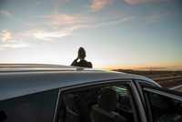 Rear view of silhouetted woman watching sunset, Mojave Desert, California, USA