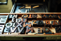 Tray of wooden letterpress letters in book arts workshop