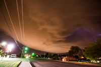 A supercell storm cloud sparking with lightning sweeping over Amarillo, Texas