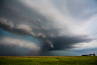 A supercell storm assumes a green colour after producing tornadoes near Felt, Oklahoma