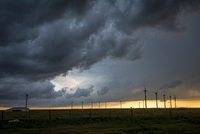 Severe storms threaten near wind turbines at sunset, south of Dumas, Texas