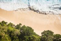 Overhead view of beach and ocean waves, Peluwang, South Coast, Nusa Penida, Indonesia