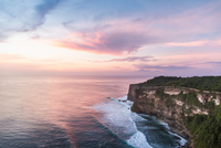 Elevated view of cliffs and sea at sunset, Uluwatu, Bali, Indonesia