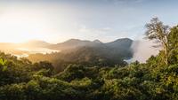Elevated view of coast and rainforest at sunset, Wana Giri, Bali, Indonesia