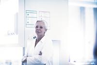 Happy scientist in laboratory
