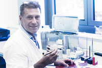 Scientist examining sample in petri dish