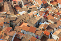 High angle view of Cefalu terracotta rooftops from La Rocca, Sicily, Italy