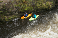 High angle view of two kayakers paddling River Dee rapids, Llangollen, North Wales