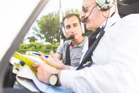 Pilot explaining flight plan to aircraft passenger