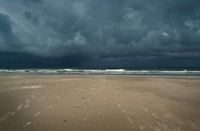 Storm clouds over beach and North sea, Nes, Friesland, Netherlands